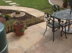 Path and garden patio paved with autumn brown sandstone