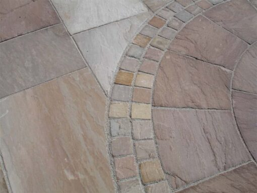 Garden patio laid with autumn blend sandstone in mixed sizes and a circle kit