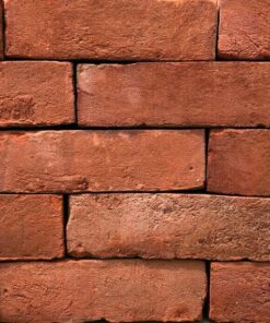 Side of a stack of soft red imperial bricks