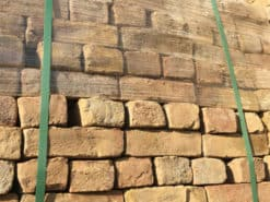 Reclaimed London yellow bricks on a pallet from below to the side