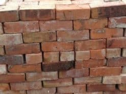 Unwrapped pallet of reclaimed Cheshire red bricks