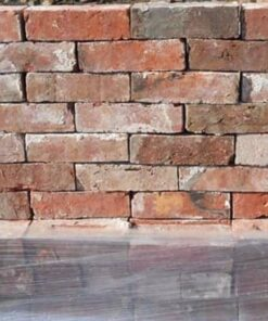 Reclaimed Cheshire red bricks stacked on top of pallet of bricks