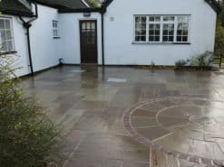 Outdoor patio area paved with Raj green circle kit and mixed size patio packs