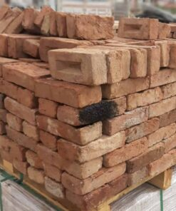 Red reclaimed bricks stacked on top of pallet