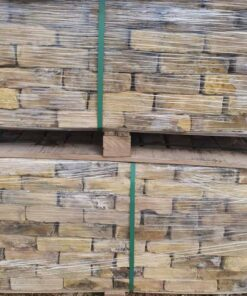 Stacked pallets of London yellow reclaimed bricks