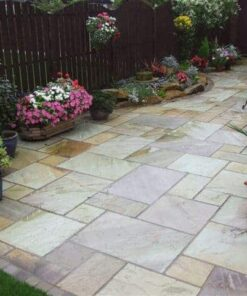 Fossil mint sandstone patio pack laid beside house