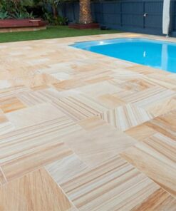 Sawn smooth Teakwood sandstone laid in garden beside outdoor pool