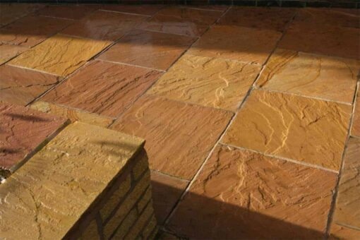 Patio and garden wall made using golden brown sandstone