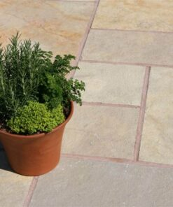 Plant pot on top of yellow limestone laid in outdoor patio