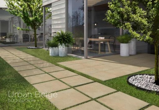 Path and patio laid using Urban beige porcelain beside house