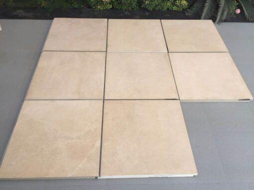 Arrangement of 8 square Urban beige porcelain paving slabs