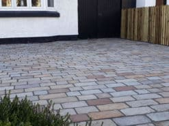 ABG tumbled sandstone cobbles outside house