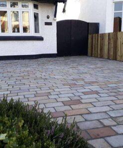 ABG tumbled sandstone cobbles outside house