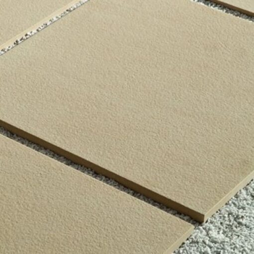 Square slabs of Avorio porcelain paving with unfilled joints