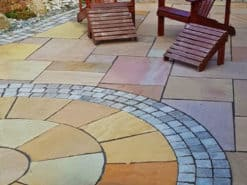Garden patio using fossil buff sandstone in mixed sizes and circle kit