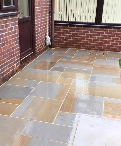 Sandblasted Indian York sandstone paving outside entrance and conservatory