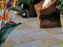 Indian york sandstone laid in garden patio with seating and plants