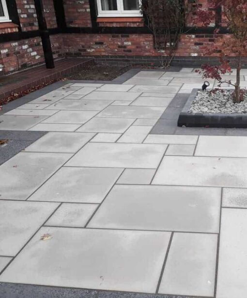 Sandblasted Kandla grey sandstone laid in courtyard