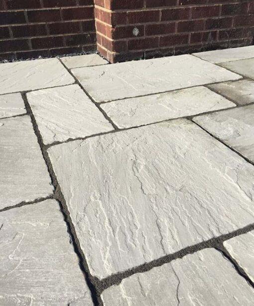 Tumbled Kandla grey sandstone patio paving outside house