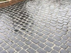 Wet Kotah black cobbles laid in garden patio
