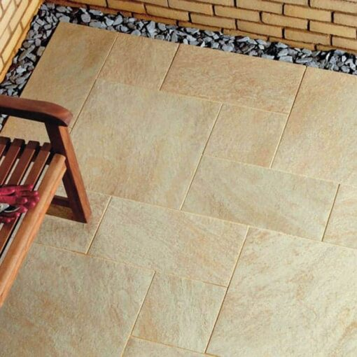 Corner of garden patio laid with Oro porcelain paving