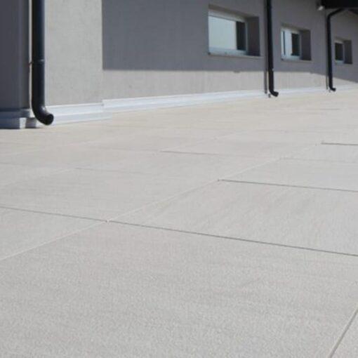 Platino porcelain paving laid alongside outside of building