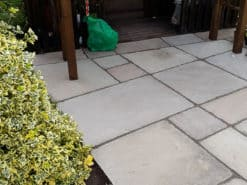 Tumbled Raj green sandstone in sheltered patio