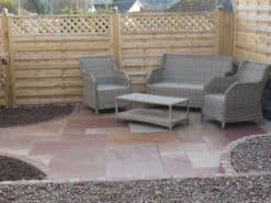 Raveena sandstone laid in garden patio with seating