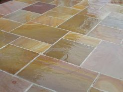 Wet Rippon buff sandstone laid by patio doors