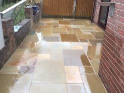 Wet sawn smooth rippon sandstone laid in walled patio
