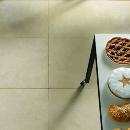 Square slabs of Sahara porcelain paving laid inside kitchen area