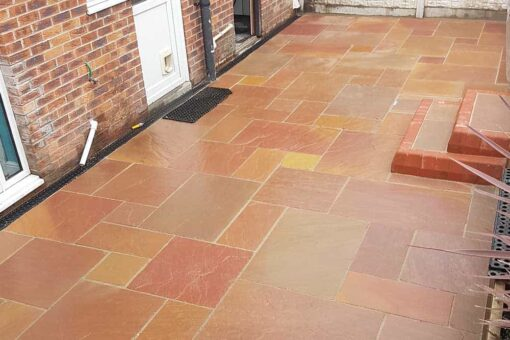 Modak sandstone laid outside back of house with stairs leading to path