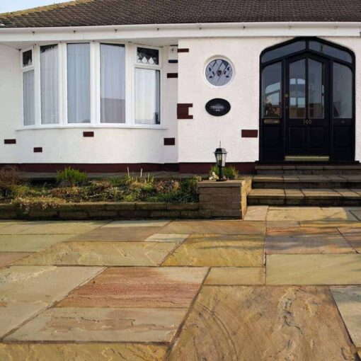 Fossil mint paving outside house with steps leading to entrance