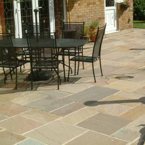 Raj green sandstone in outside patio area with table and chairs