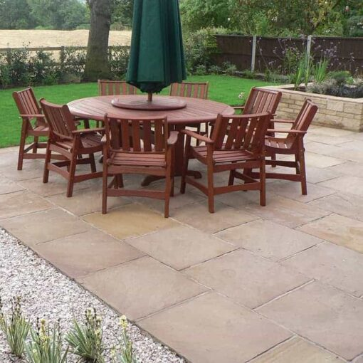 Autumn Brown sandstone garden patio with table and chairs