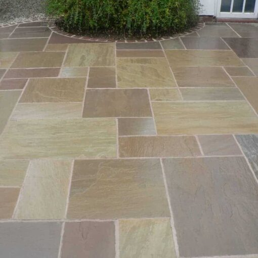 Mixed sizes of Raj green sandstone laid in outdoor patio area
