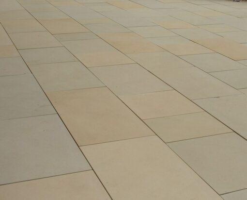 Raj Green sawn smooth sandstone laid in straight lines