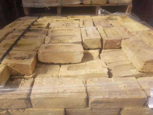 Pallet of London Yellow bricks showing top side of brick