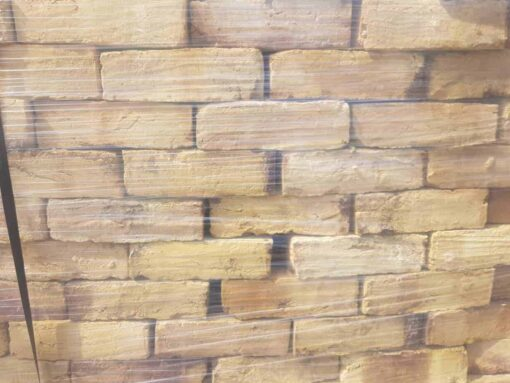 Side of pallet of wrapped London Yellow stock bricks