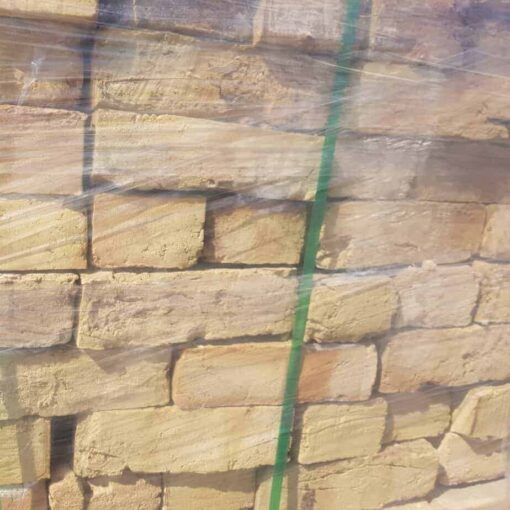 Closeup of side of wrapped pallet of London Yellow stock bricks
