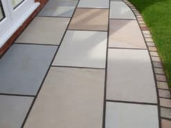 Sandblasted rippon buff sandstone laid in garden patio