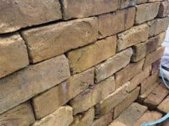 Stack of Funton yellow stock bricks on top of pallet of bricks
