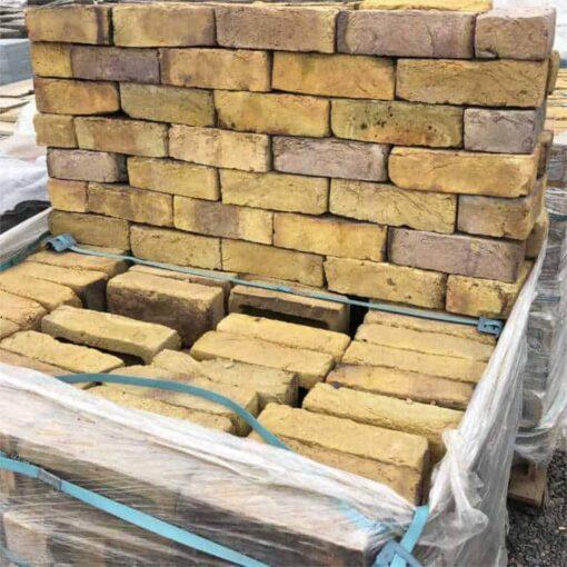 Funton yellow stock bricks stacked on top of each other on top of a pallet of Funton yellow bricks