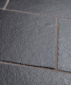 Close-up of mixed size slabs of Kotah Black Tumbled slabs